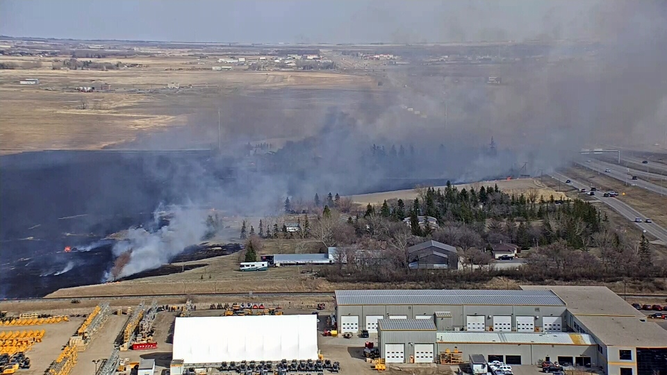A large grassfire is burning in east Regina.