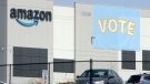 In this Tuesday, March 30, 2021 file photo, a banner encouraging workers to vote in labor balloting is shown at an Amazon warehouse in Bessemer, Ala. (AP Photo/Jay Reeves, File)