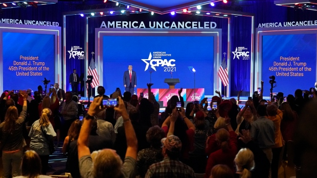 Supporters cheer and wave as former U.S. president Donald Trump is introduced at the Conservative Political Action Conference Sunday, Feb. 28, 2021, in Orlando, Fla. (AP Photo/John Raoux)