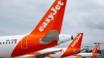 In this Monday, March 30, 2020 file photo, a large number of EasyJet aircrafts parked on the tarmac of the Geneve Aeroport, in Geneva, Switzerland. (Salvatore Di Nolfi/Keystone via AP, File)