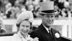 In this June 19, 1962 file photo, Prince Philip and his wife Queen Elizabeth II arrive at Royal Ascot race meeting, England. (AP Photo/File)