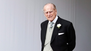 Prince Philip waits for the bridal procession following the wedding of Princess Eugenie of York and Jack Brooksbank in St George's Chapel, Windsor Castle, near London, England, on Friday, Oct. 12, 2018. (AP Photo/Alastair Grant)