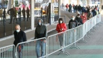 People wait in line at a COVID-19 vaccination clinic to receive the AstraZeneca vaccine at Olympic Stadium in Montreal, on Thursday, April 8, 2021. Quebecers 55 and over can now get the AstraZeneca vaccine at walk-in clinics across the province. THE CANADIAN PRESS/Paul Chiasson