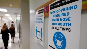 A sign reminds students to wear masks and distance themselves at Fox Trail Elementary School in Davie, Fla., on Oct. 9, 2020. (Wilfredo Lee / AP)