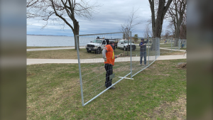 City of Kingston staff install fencing around Breakwater Park on Friday. (Kimberley Johnson/CTV News Ottawa)