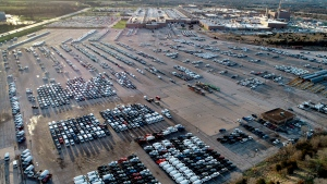 A General Motors assembly plant is seen while mid-sized pickup trucks and full-size vans currently produced at the plant are seen in a parking lot outside Wednesday, March 24, 2021, in Wentzville, Mo. (AP Photo/Jeff Roberson)