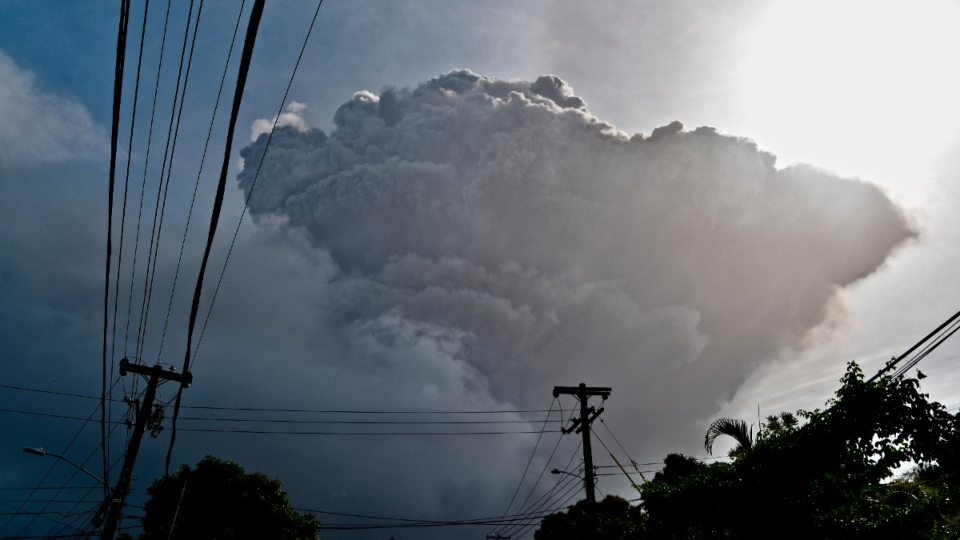 Ash rises into the air as La Soufriere volcano erupts on St. Vincent, seen from Chateaubelair, on April 9, 2021. (Orvil Samuel / AP)