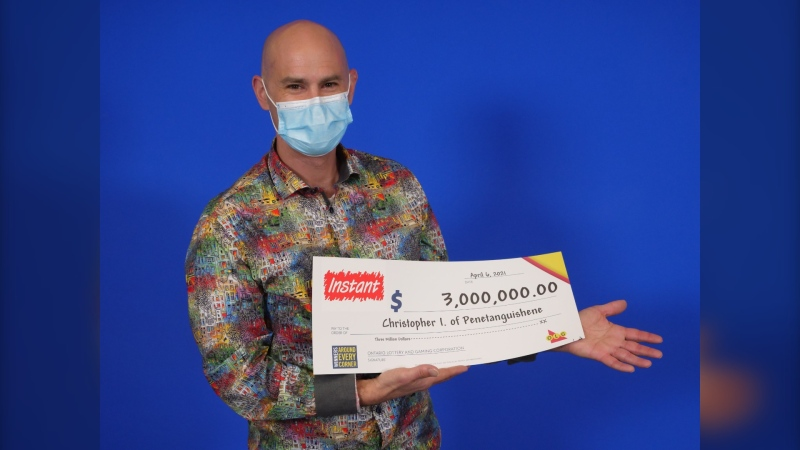 Chris Irvine, 47, of Penetanguishene, Ont. holds his big cheque from the Ontario Lottery and Gaming Commission. (Supplied)