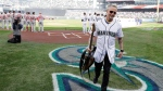 Pearl Jam guitarist Mike McCready carries his guitar after performing the national anthem before a baseball game between the Seattle Mariners and the Boston Red Sox, Thursday, March 28, 2019, in Seattle. AP Photo/Ted S. Warren
