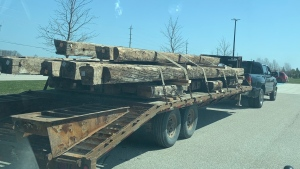 A truck lugging a trailer with lumber is pulled over by the Huronia West OPP for multiple infraction in Clearview Township, Ont. on April 8, 2021 (Supplied)