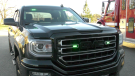 A pick-up truck decked out with green flashing lights for volunteer firefighters. (Nate Vandermeer/CTV News Ottawa)
