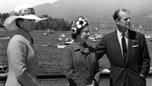 The Queen, centre, Prince Philip, right, and Princess Anne relax as they sail to Victoria, B.C., on May 3, 1971 accompanied out of Vancouver harbour by numerous small craft. (THE CANADIAN PRESS / Bill Croke)