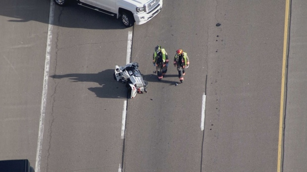A motorcycle is seen on Highway 427 near Eglinton Avenue after a crash on April 9, 2021. (CTV News Toronto)