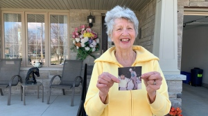 Janet Johnson shows a photo of Prince Philip from her encounter with him in the 1960s (Krista Sharpe / CTV News Kitchener)
