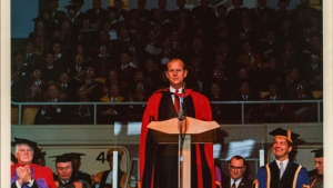 Photograph of HRH Prince Phillip at podium during the installation ceremony for UVic President Bruce Partridge. Image adjusted for shadows and contrast: (University of Victoria Archives and Special Collections)
