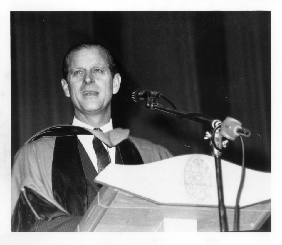 Black and white image of Prince Phillip at podium, receiving UVic's first Honorary Doctor of Science Degree. (University of Victoria Archives and Special Collections)