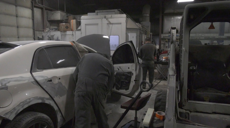 Auto body technicians work on vehicles at Vernaus Auto Body in Winnipeg on Apr.9, 2021. (Source: Josh Crabb/ CTV News Winnipeg)