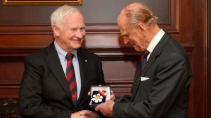 Prince Philip, the Duke of Edinburgh (right), receives his medal of Companion of the Order of Canada from Governor General David Johnston in Toronto on Friday April 26, 2013. THE CANADIAN PRESS/Nathan Denette