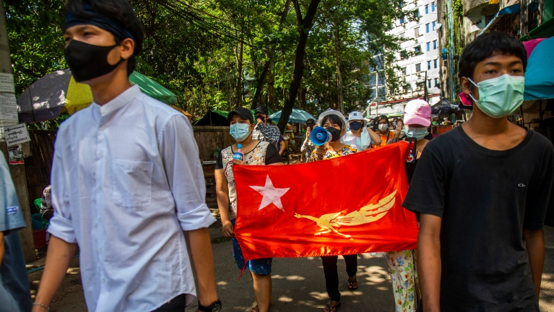 Protesters chant slogans and march in the street of Myaynigone township during the anti-coup demonstration in Yangon, Myanmar, Friday, April 9, 2021. (AP Photo)