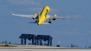 A Spirit Airlines Airbus A320 takes off from Fort Lauderdale-Hollywood International Airport, Tuesday, Jan. 19, 2021, in Fort Lauderdale, Fla. (AP Photo/Wilfredo Lee)