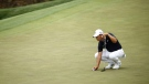 Golfer Si Woo Kim slammed his putter in the ground in anger, breaking it in the process at the Masters on Friday. (Jared C. Tilton/Getty Images/CNN)