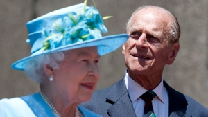 Queen Elizabeth and Prince Philip, the Duke of Edinburgh, take part in the unveiling of a statue of jazz legend Oscar Peterson at the National Arts Centre in Ottawa on June 30, 2010. THE CANADIAN PRESS/Sean Kilpatrick