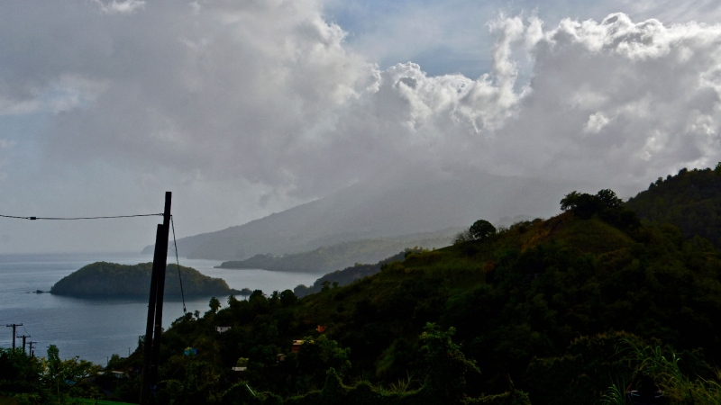 Ash rises into the air as La Soufriere volcano erupts on the eastern Caribbean island of St. Vincent, seen from Chateaubelair, Friday, April 9, 2021. (AP / Kepa Diez Ara)