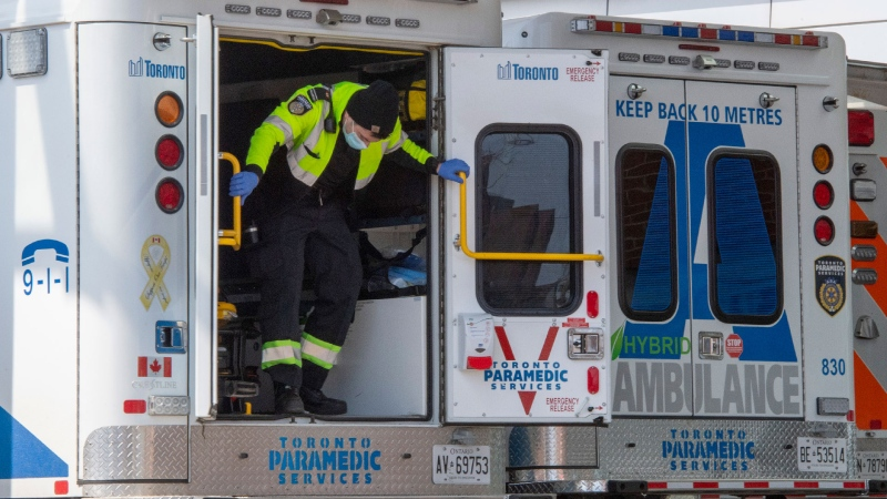 A paramedic closes the doors on his ambulance at a hospital in Toronto on Tuesday, April 6, 2021. As ICU beds fill up in the city patients are being transferred to hospitals in other regions. THE CANADIAN PRESS/Frank Gunn