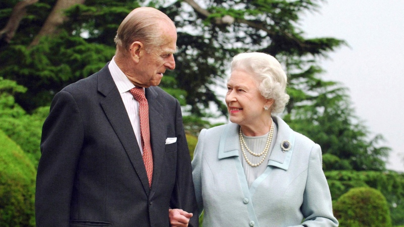 In this Nov. 18, 2007 file photo, Queen Elizabeth II and the Duke of Edinburgh at Broadlands. (Fiona Hanson/PA via AP, File)