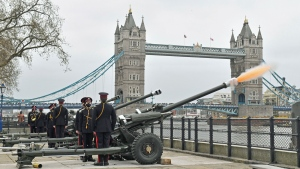 Members of the Honourable Artillery Company fire a 41-round gun salute from the wharf at the Tower of London, to mark the death of Prince Philip, in London, Saturday, April 10, 2021. (Dominic Lipinski/PA via AP)