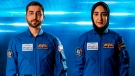 In this undated handout photograph from the United Arab Emirates' state-run WAM news agency, newly named Emirati astronauts Mohammed al-Mulla, left, and Noura al-Matroushi, right, pose for a photo. The United Arab Emirates named the next two astronauts in its space program Saturday, April 10, 2021, including the country's first female astronaut. (WAM via AP)