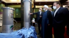 In this photo released by the official website of the office of the Iranian Presidency, President Hassan Rouhani, second right, listens to head of the Atomic Energy Organization of Iran Ali Akbar Salehi while visiting an exhibition of Iran's new nuclear achievements in Tehran, Iran, Saturday, April 10, 2021. Iran said Saturday it has begun mechanical tests on its newest advanced nuclear centrifuge, even as the five world powers that remain in a foundering 2015 nuclear deal with Iran attempt to bring the U.S. back into the agreement. (Iranian Presidency Office via AP)