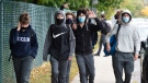Students from Lasalle Community Comprehensive High School walk out of class to protest COVID-19 safety concerns Thursday, October 1, 2020 in Montreal.THE CANADIAN PRESS/Ryan Remiorz