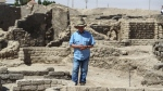 Zahi Hawass talks to media in a 3,000-year-old lost city in Luxor province, Egypt, Saturday, April 10, 2021. The newly unearthed city is located between the temple of King Rameses III and the colossi of Amenhotep III on the west bank of the Nile in Luxor. The city continued to be used by Amenhotep III's grandson Tutankhamun, and then his successor King Ay. (AP Photo/Mohamed Elshahed)