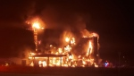 A hotel under construction on fire in Bradford, Ont. on Sat. April 10, 2021 (South Simcoe Police/Twitter)