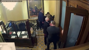 In this image from video, a security video shows Vice President Mike Pence being evacuated as rioters breach the Capitol. (Senate Television via AP)