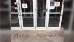 Vandalism seen outside an Alberta Health Services in April (Supplied)