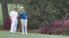 Jace Walker (L) and Mackenzie Hughes ( R) discuss a shot at on the par 5 13th at the Masters Thursday, Apr 8.  (Source: TSN/PGA)