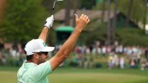 Corey Conners, of Listowel, Ont., celebrates after a hole-in-one on the sixth hole during the third round of the Masters golf tournament on Saturday, April 10, 2021, in Augusta, Ga. (AP Photo/Charlie Riedel)