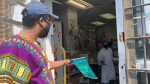 Farah Aw-Osman of the Centre for Resilience and Social Development hands out information on the COVID-19 vaccine in a high-risk Ottawa neighbourhood. (Jackie Perez/CTV News Ottawa)