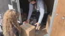The Best Friends of Big Brothers Big Sisters of Waterloo Region load up items for their fundraising initiative. (Jessica Smith/CTV Kitchener) (Apr. 10, 2021)