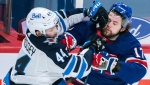 Montreal Canadiens' Josh Anderson (17) collides with Winnipeg Jets' Josh Morrissey during first period NHL hockey action in Montreal, Saturday, April 10, 2021. THE CANADIAN PRESS/Graham Hughes