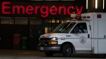 An ambulance drives past the emergency entrance of Vancouver General Hospital in Vancouver, B.C., Friday, April 9, 2021. THE CANADIAN PRESS/Jonathan Hayward