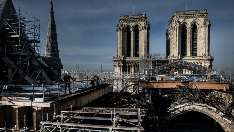 The first task for workers on Notre-Dame cathedral has been removing hundreds of tonnes of scaffolding that were damaged in the fire. (AFP)