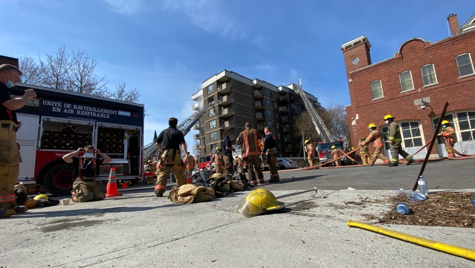 Montreal firefighters battle a blaze that broke out at a senior's residence in Montreal's Southwest borough on April 11, 2021. (Iman Kassam, CTV News)