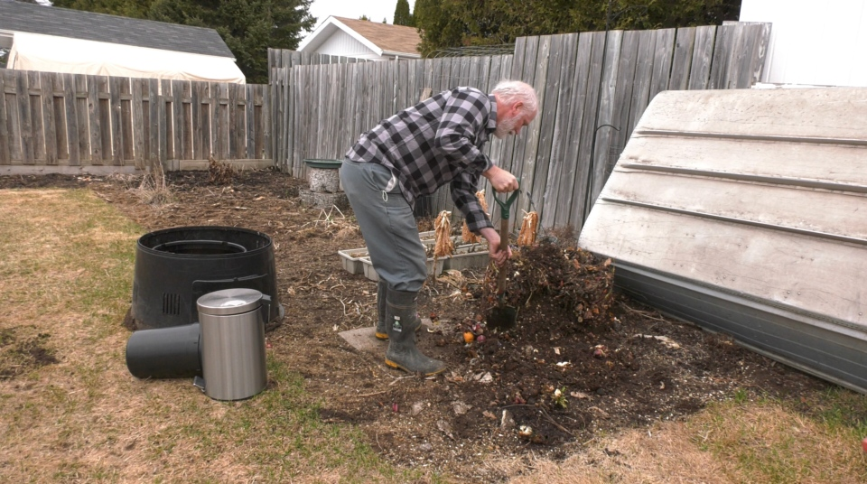 Mark Joron of Timmins examines the layers in his composting bin as he gets ready to move it to a new location in his garden.  April 11/21(Lydia Chubak/CTV News Northern Ontario)