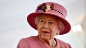In this Thursday Oct. 15, 2020 file photo, Britain's Queen Elizabeth II visits the Defence Science and Technology Laboratory (DSTL) at Porton Down, England, to view the Energetics Enclosure and display of weaponry and tactics used in counter intelligence. (Ben Stansall/Pool via AP, file)