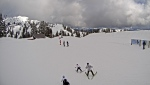 Skiers head out on the slopes at Mt. Seymour Resort in North Vancouver, B.C. on Sunday, April 11, 2021 (Mt. Seymour Resort/webcam).