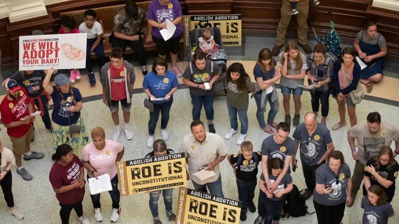 In this file photo, pro-life demonstrators gather in the rotunda at the Capitol while the Senate debated anti-abortion bills on Tuesday, March 30, 2021. (Jay Janner/Austin American-Statesman via AP)