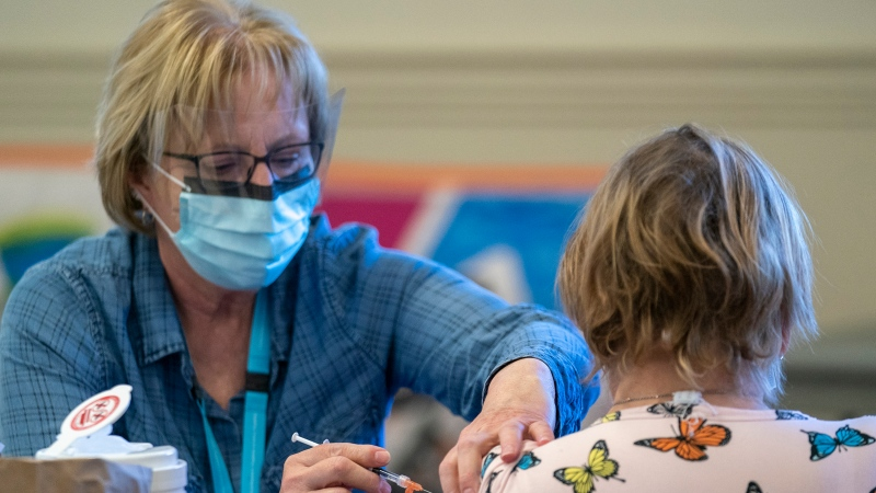 A person receives a COVID-19 vaccine at a vaccination clinic run by Vancouver Coastal Health, in Richmond, B.C., Saturday, April 10, 2021. THE CANADIAN PRESS/Jonathan Hayward